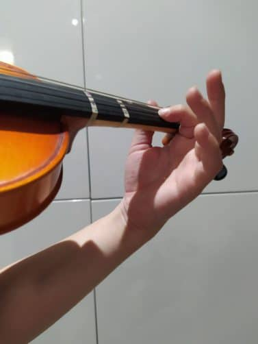 violin student learning to do vibrato with exercises