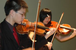 violin students learn exercises for g major in three octaves