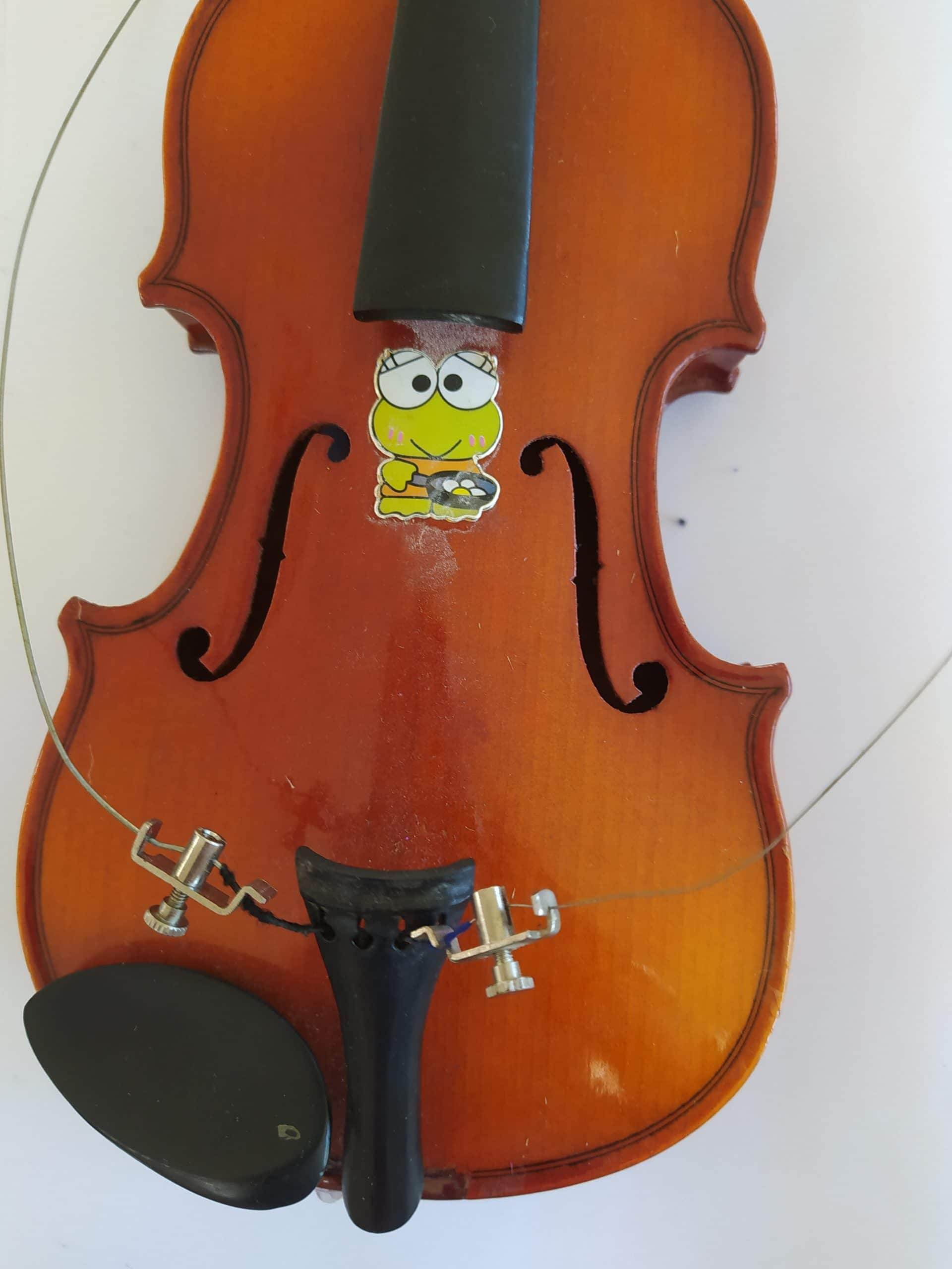 violin with all the strings removed and broken